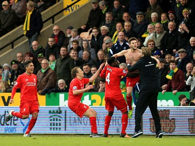 Adam Lallana (2nd R) celebrates scoring his team's fifth goal with his manager Jurgen Klopp (1st R) and team mate Kolo Toure (3rd R), Lucas Leiva (2nd L) and Roberto Firmino (1st L) during the Barclays Premier League match between Norwich City and Liverpool. Getty