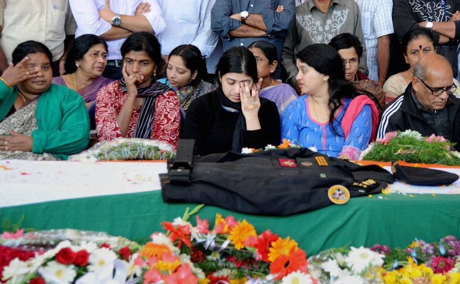 """Lt Col Niranjan Kumar's wife Radhika (centre) and other family members pay their last respects to the martyred soldier. """"He was always interested in the army. I am proud of his sacrifice,"""" Niranjan's father Sivarajan said. Niranjan's sister said, """"I look at him as Arjuna who fought for his karmabhoomi."""" PTI"""