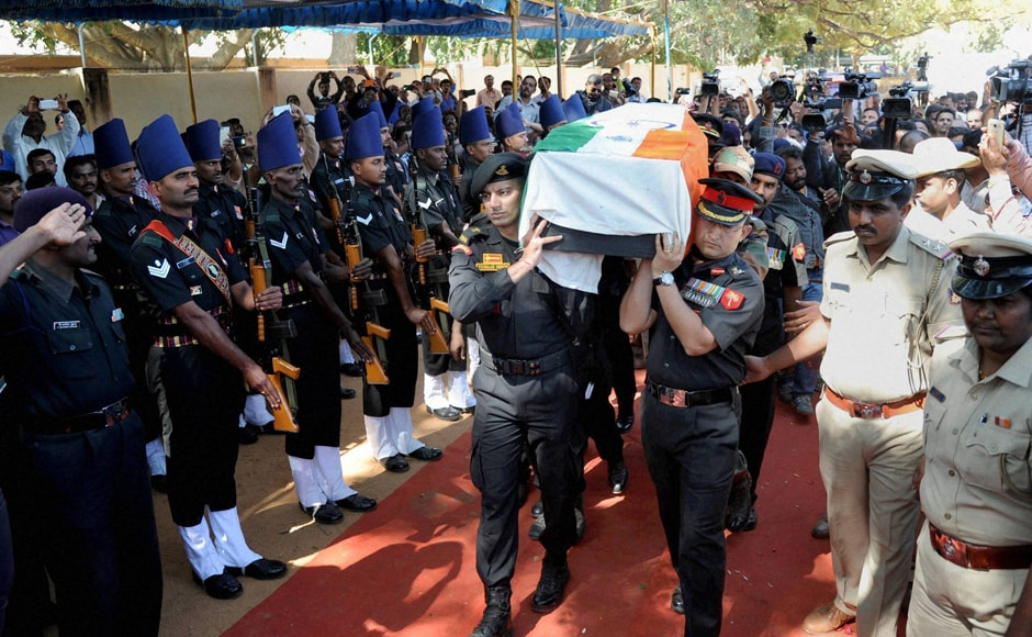 Army personnel carry the mortal remains of Lt Col Niranjan Kumar at his home in Bengaluru on Monday. His body was later flown from the Jalahalli airbase to his hometown of Palakkad, Kerala. PTI