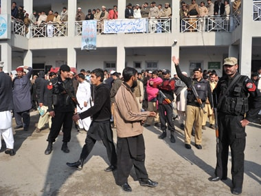 Security personnel cordoned off Bacha Khan University after gunmen attacked and killed 21 people. AFP