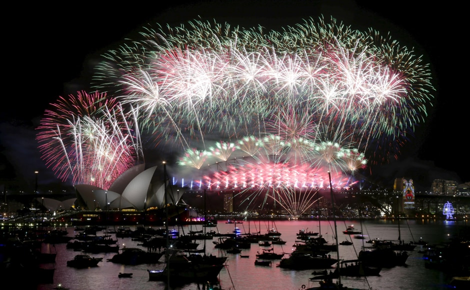 Fireworks explode over the Sydney Opera House and Harbour Bridge as Australia's largest city ushers in the New Year. Reuters