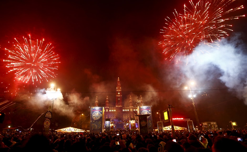 A massive firework display is seen in the crowded sqaure in front of Vienna's city hall in Austria. Reuters