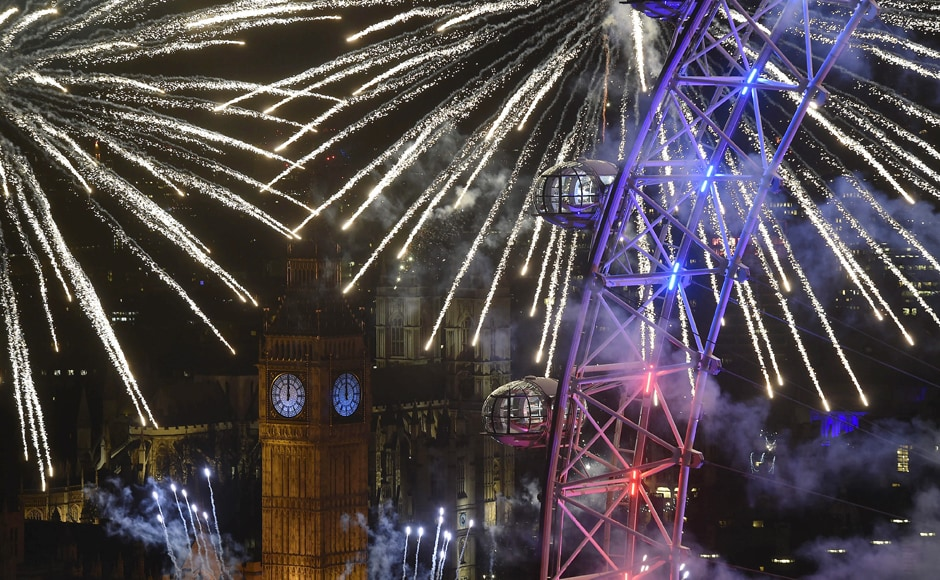 Firworks over London Eye and the Big Ben mark the beginning of the New Year in London. Reuters