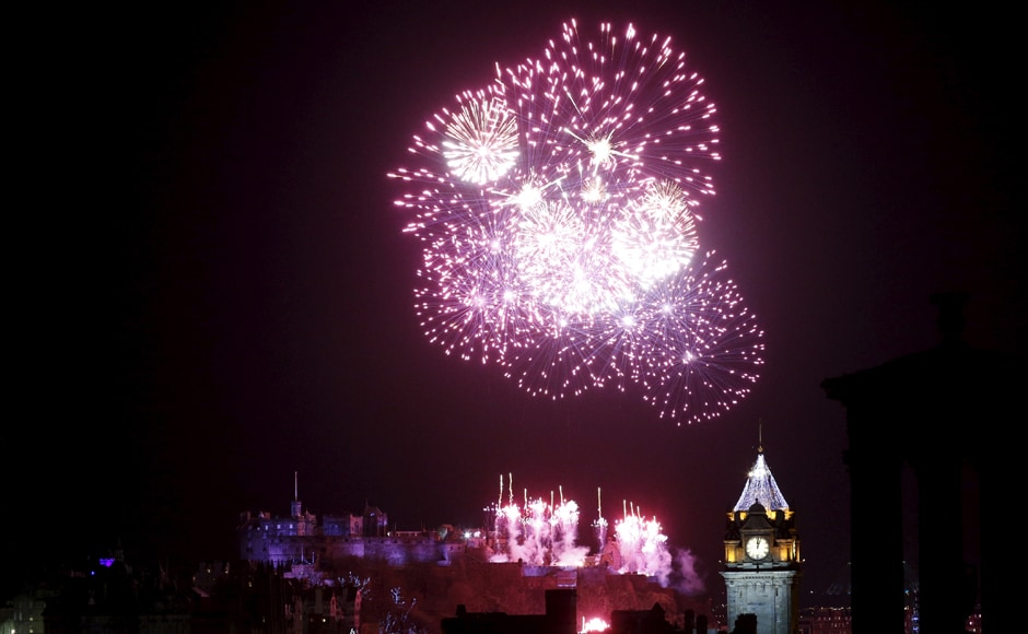 A brilliant firework display is seen over the castle in Edinburgh, Scotland. Reuters