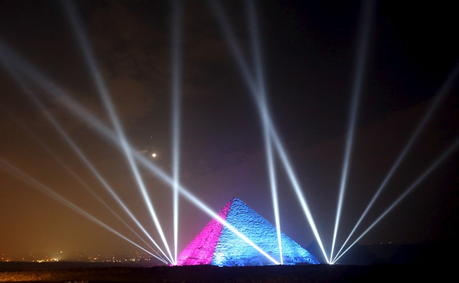 Egyptians celebrate in front of great pyramids during New Year's day celebrations in Cairo. Reuters