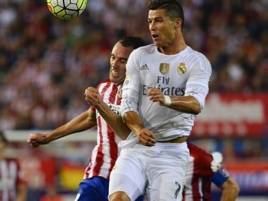 Atletico Madrid's Diego Godin clashes with Real Madrid's Cristiano Ronaldo. AFP