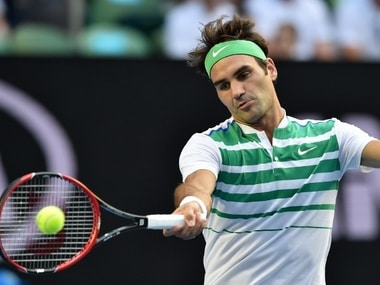 Roger Federer in action in the first round of Australian Open. AFP