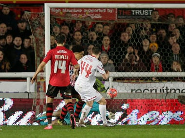 Brad Smith scores the second goal to help Liverpool equalise. Reuters