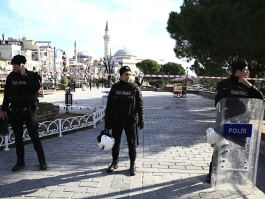 Policemen secure an area at the historic Sultanahmet district, which is popular with tourists, after an explosion in Istanbul. AP
