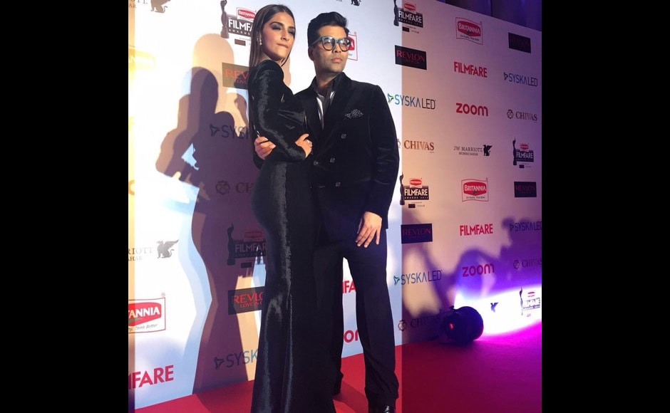 "Fashionista Sonam Kapoor and Karan Johar pose at the Film Fare Awards. While the award ceremony hasn't yet been screened on TV, we got a sneak peek at the photos. ""By far the sassiest duo on the red carpet tonight, Sonam Kapoor and Karan Johar slay it at the,"" the Film Fare Instagram said. Image courtesy: @filmfare/Instagram"