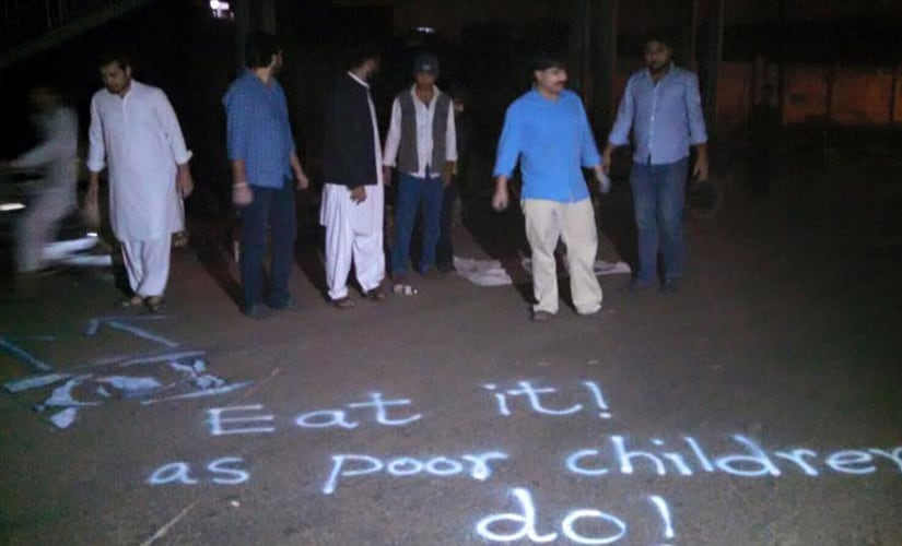 They also spray painted 'Eat it! As poor children do' pointing to garbage bins, highlighting that the city's poor children often pick food from garbage bins. Image Courtesy: Facebook/Alamgir Khan