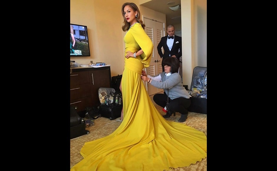 "Here Jennifer Lopez is gearing up to go to the Golden Globes. And of course she looks impeccable. ""Just about ready... "" she says on the photo. Image courtesy: @jlo/Instagram"