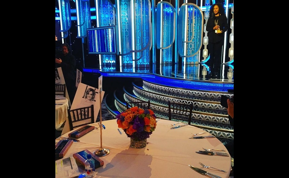 "A closer look at those fancy tables at award ceremonies. ""Help. I have to ""act professional"" all night. #goldenglobes,"" says Katy Perry. Image Courtesy: @katyperry/Instagram"