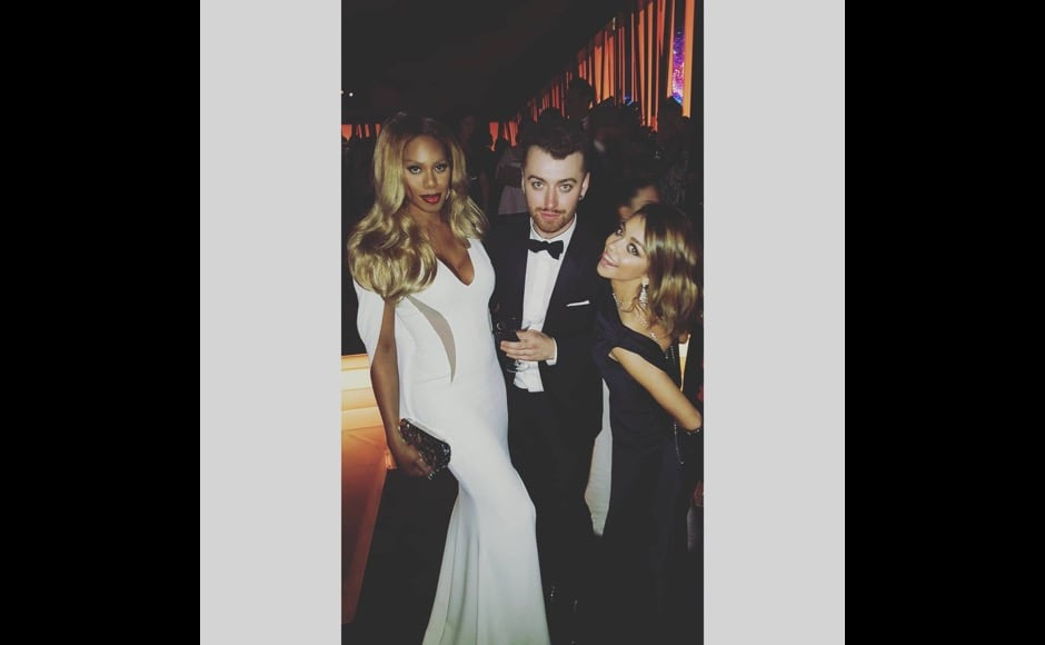 """Look how beautiful @samsmithworld and @therealsarahhyland look at last night's #GoldenGlobes @instylemagazine party #TransIsBeautiful,"" Laverne Cox says in this after party photo. Image courtesy: @lavernecox/Instagram"