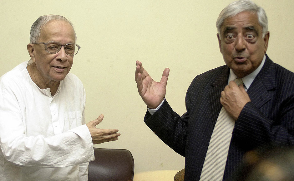 Former chief minister of the Indian state of West Bengal Jyoti Basu (L) shares a joke with Mufti Mohammad Sayeed after a courtesy meeting at Basu's residence in Calcutta on 25 September, 2004. Sayeed was in the city to attend a tourism fair and promote tourism in Jammu and Kashmir. Sayeed invited Basu to come to the mountainous state for a holiday. AFP
