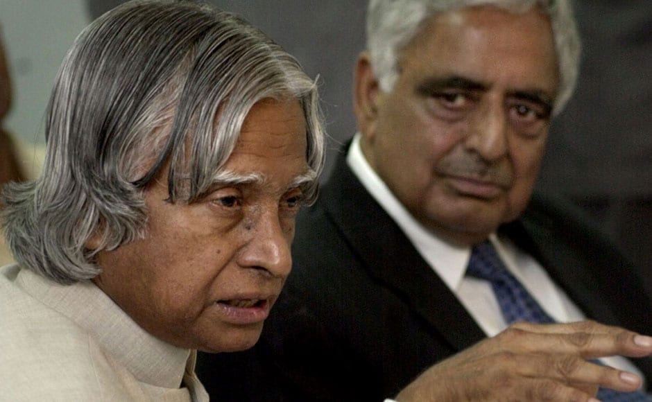 Abdul Kalam (L) gestures during a meeting at the Information Technology Park in the outskirts of Srinagar on 27 June 2003 as Mufti Mohammad Sayeed looks on. Kalam arrived at the insurgency-hit city after police reported another six people killed in continuing separatist-linked violence. AFP