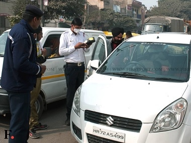 A file image of challan being issued for non-compliance of the Odd-Even rule. Firstpost.