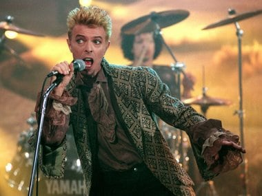 A photo taken on February 22, 1997 shows British rock music legend David Bowie performing on stage during the German TV program. AFP