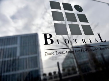 (FILES) This file photo taken on 16 January, 2016 shows the logo of the Biotrial laboratory on its building in Rennes, western France, where a clinical trial of an oral medication left one person brain-dead and five hospitalised.  AFP