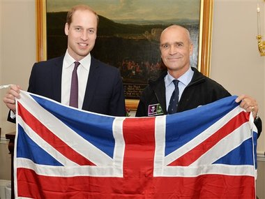 FILE - This is a  October 19, 2015  file photo of former Army officer Henry Worsley, right, with Britain's Prince William as they hold the British flag in London.  AP