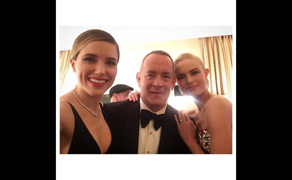 """I must #mcm Tom Hanks today. This lovely man pep-talked my #ppc -- presenting-partner-in-crime -- @katebosworth and I backstage last night, and helped us calm our nerves before we took the stage. Then she and I held hands as we waited in the wings, and hey we made it! #NobodyTripped #LadyLove #GirlCrushSinceBlueCrush #AndYesLightAlwaysShinesOutOfHerFace #ActuallyAllOfTheTime #ShesBornWithIt #GoldenGlobes,"" Sophia Bush said on this photo. Image courtesy: @sophiabush/Instagram"