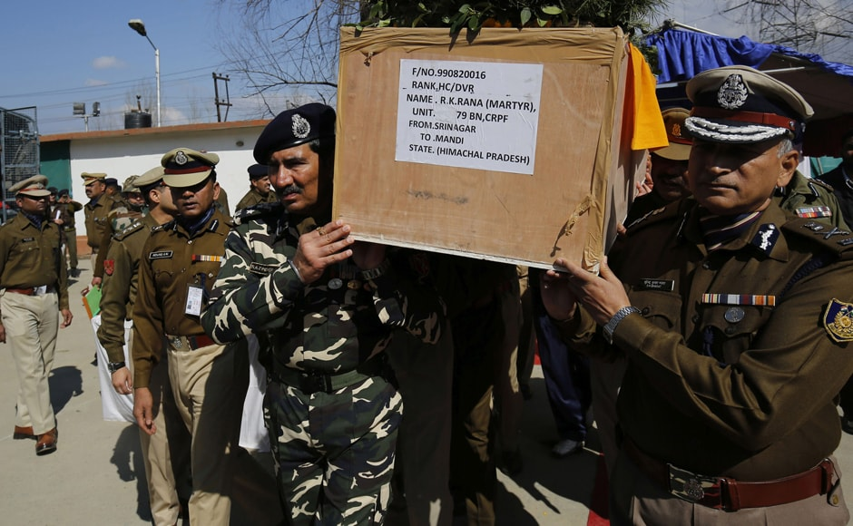 CRPF personnel carry the mortal remains of a soldier killed during the confrontation. AFP