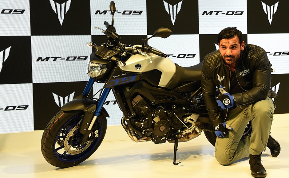 Bollywood actor John Abraham poses with the newly launched Yamaha MT-09 motorcycle at the Indian Auto Expo 2016. AFP/Sajjad Husain