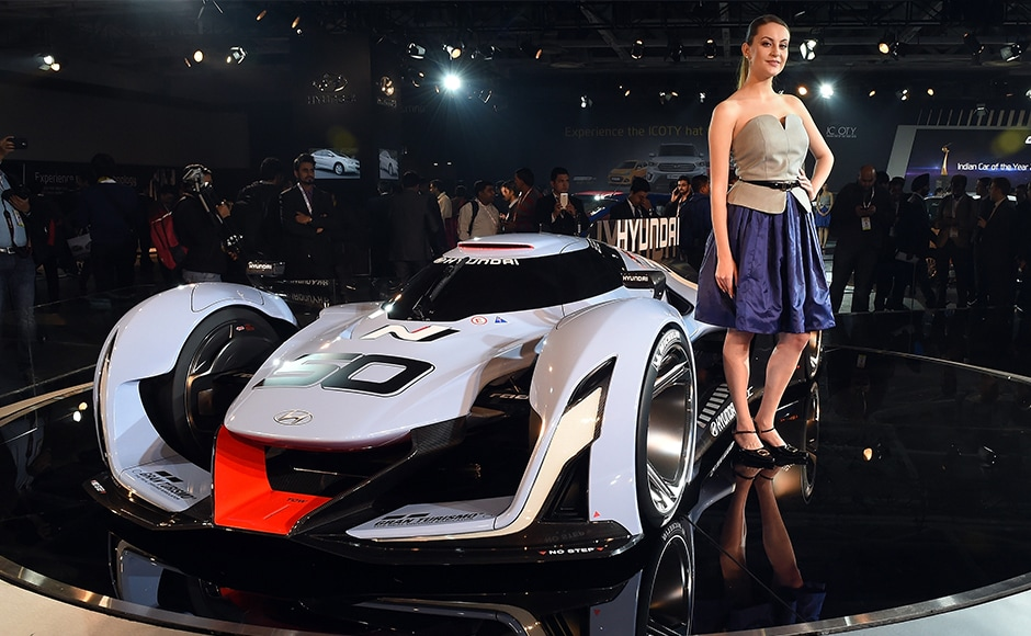 An model poses with Hyundai's concept car at the Indian Auto Expo 2016. AFP/Prakash Singh