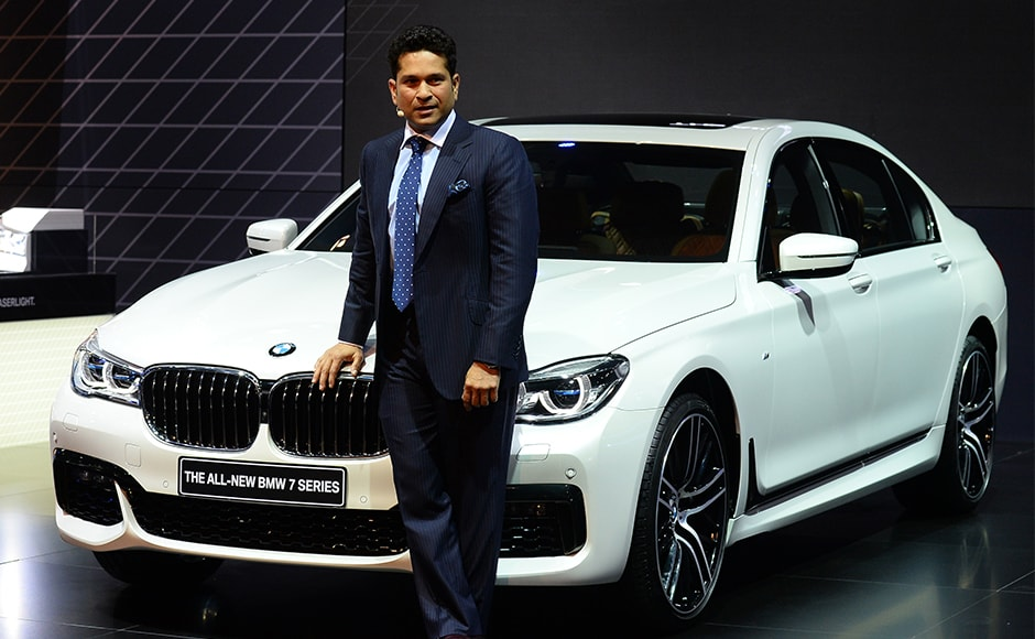 Indian former cricketer Sachin Tendulkar poses with the newly launched BMW 7 series at the Indian Auto Expo 2016. AFP/Sajjad Hussain