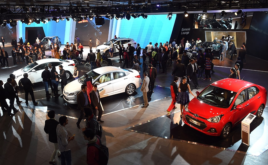 Visitors gather at Hyundai's pavilion at Auto Expo 2016. More than 80 vehicle launches were expected at the Auto Expo 2016, the biggest edition in the show's 30-year history, with the Fiat Chrysler-owned Jeep making its India debut and hoping to capitalise on the popularity of sports utility vehicles. AFP/Prakash Singh