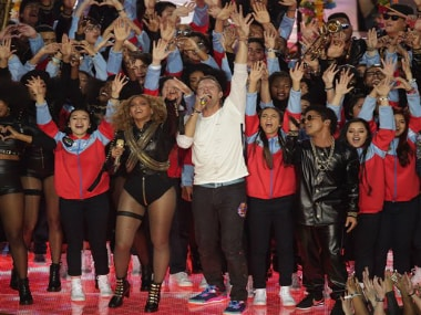 Beyonce, Martin and Mars on the Super Bowl stage. AP