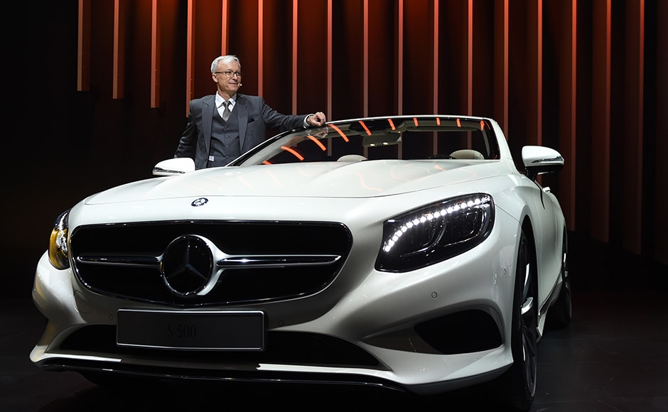 Roland Folger, managing director and CEO of Mercedes Benz India, poses with the S500 Mercedes Benz car at the Indian Auto Expo 2016. AFP/Sajjad Hussain