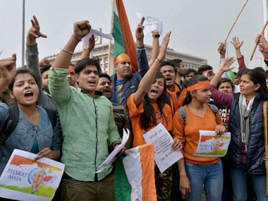 ABVP activists protest against an event at JNU supporting Parliament attack convict Afzal Guru in New Delhi on Friday. PTI