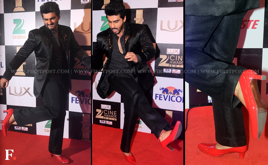 Arjun Kapoor is definitely pulling off the androgynous look with his red heels! He wore these Manish Malhotra kitten heels to promote his upcoming move <em>Ki and Ka </em>and incidently, the film's song 'High Heels' sung by rapper Yo Yo Honey Singh releases on Sunday. Sachin Gokhale/Firstpost
