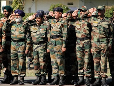 Army jawans paying tribute to to Captain Tushar Mahajan who lost his life in a gun-battle with the militants in Pampore, in Udhampur on Monday. PTI