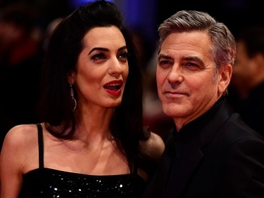 George Clooney and his wife Amal Alamuddin arrive for the screening of Hail, Caesar! at the 66th Berlinale Film Festival in Berlin. AFP