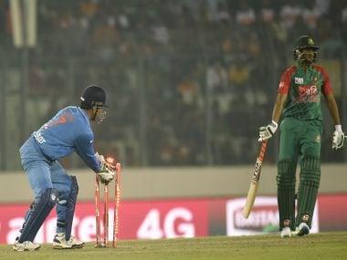 Mahendra Singh Dhoni takes the wicket of Shakib Al Hasan. AFP