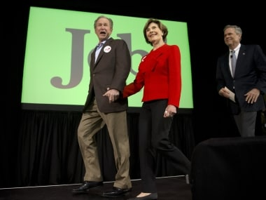 Republican presidential candidate and former Florida Gov Jeb Bush, accompanied by his brother former President George W Bush and George's wife Laura Bush. AP