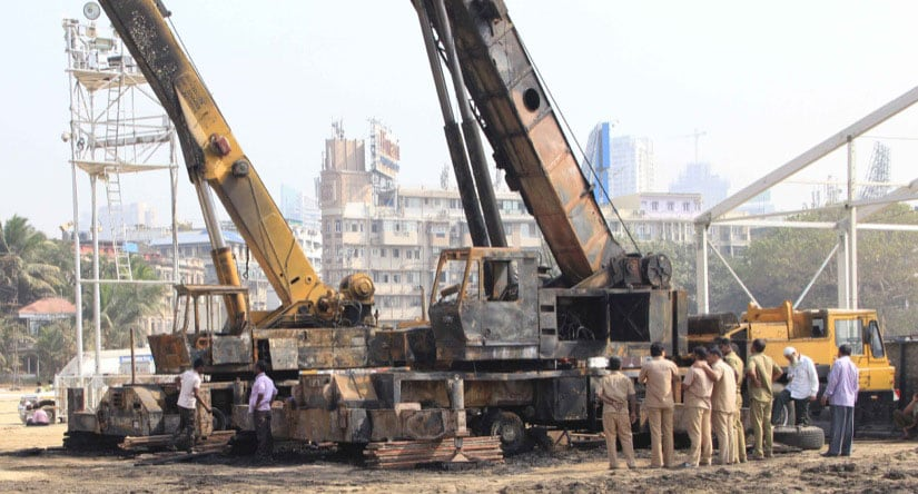 Workers at work at the Make in India venue in Mumbai on Tuesday. Image courtesy Deepak Salvi