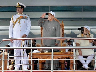 President Pranab Mukherjee, Prime Minister Narendra Modi, and Chief of Naval Staff Admiral RK Dhowan at the International Fleet Review and Flypast in Visakhapatnam on Saturday. PTI Photo(PTI2_6_2016_000046B) *** Local Caption ***