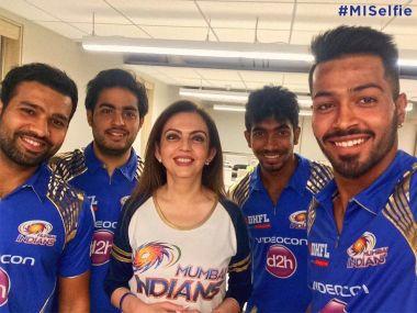 One franchise three India caps. Rohit Sharma, Bumrah and Hardik Pandya do a selfie with owners Nita Ambani and Akash Ambani. Image: Firstpost
