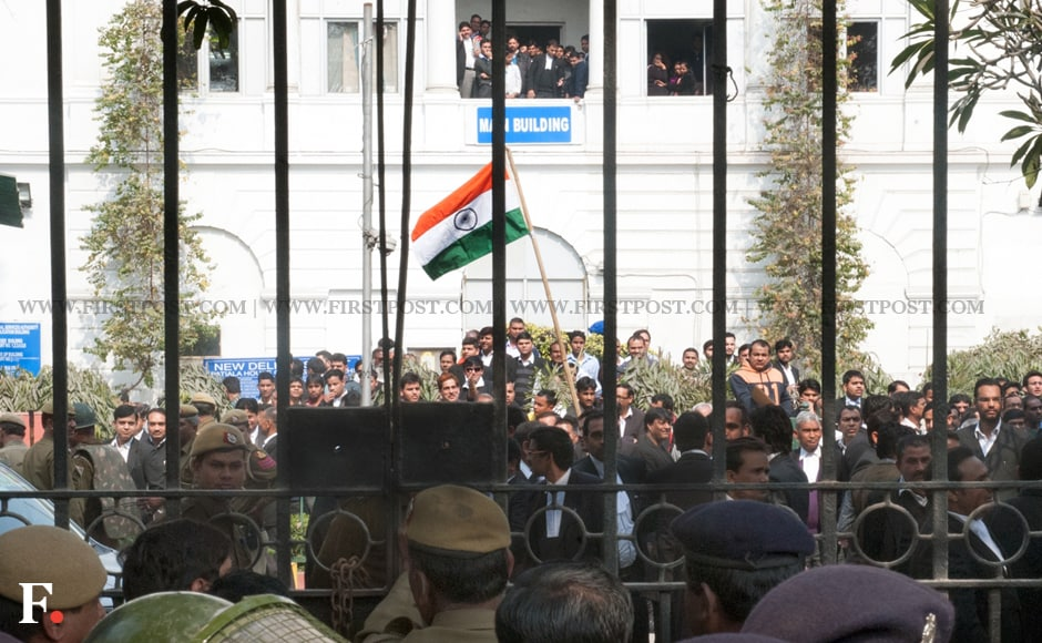 A lawyer waves a Tricolour at Patiala House Court where JNUSU President Kanhaiya Kumar, arrested on charges of sedition, was being produced. Naresh Sharma/Firstpost