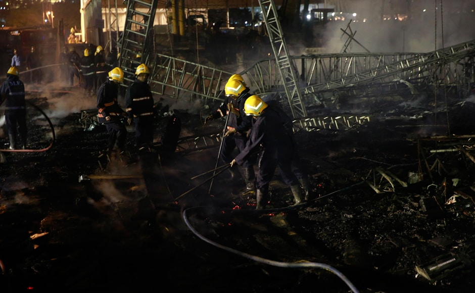 Fire fighters douse the fire which broke out during the event. No casualties were reported. AP/Rafiq Maqbool