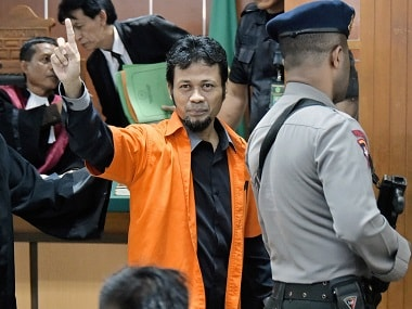 Suspected Islamic radical identified as Muhammad Fachry (C) gestures during his court appearance in Jakarta. AFP