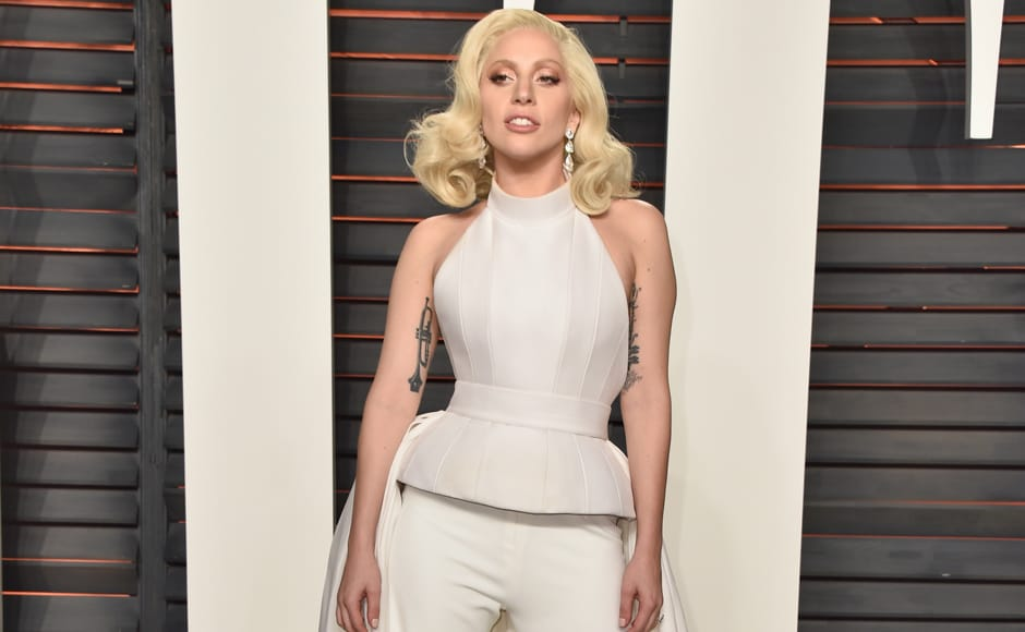 For once, the only thing standing out in Lady Gaga's look is her Trumpet tattoo. (Getty Images)