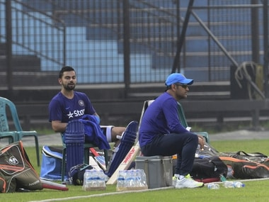 India captain Mahendra Singh Dhoni and teammate Virat Kohli attend a training session at the Khan Shaheb Osman Ali Stadium in Fatullah on 23 February, 2016. AFP