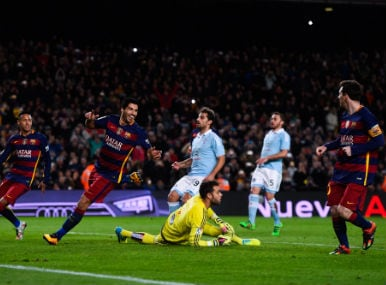 Lionel Messi passes the ball for Luiz Suarez to strike home during the penalty kick against Celta Vigo. Getty