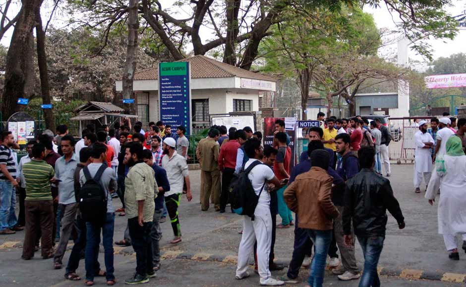 """Students and relatives gather outside the Abeda Inamdar college in Pune, India. Maharashtra Chief Minister Devendra Fadnavis tweeted that he was """"extremely saddened & shocked to know about the Murud incident where 14 students lost their lives."""" Solaris Images"""