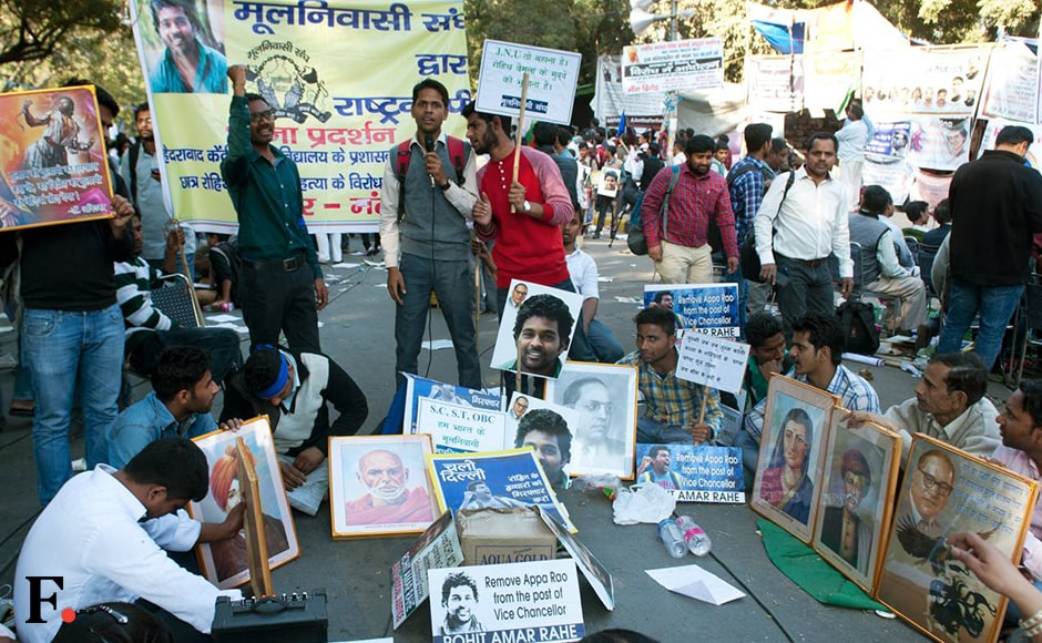 Protesters hold up placards with photographs of Rohith Vemula, the University of Hyderabad student who committed suicide earlier this year, and Dr Babasaheb Ambedkar, the architect of the Constitution. Vemula's mother Radhika and brother Raja also participated in the march. Naresh Sharma/Firstpost