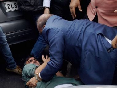 BJP MLA OP Sharma assaulting CPI(M) activist in New Delhi on Monday. PTI